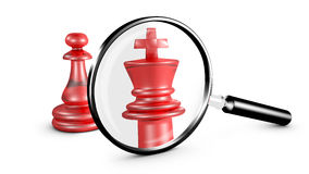 Magnifying glass reveals a pawn like a king. Royalty Free Stock Photography