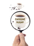 Magnifying glass of roasted coffee beans Stock Photos