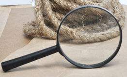 Magnifying glass and rope Stock Image