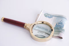 Magnifying glass and russian money Stock Photography