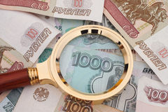 Magnifying glass and russian money Royalty Free Stock Image