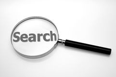 Magnifying glass - search. Magnifying glass and some text (search Stock Images