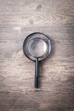 Magnifying glass, Search and discover symbol. Magnifying glass on wooden background Stock Images