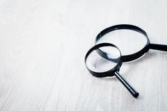 Magnifying glass, Search and discover symbol. Magnifying glass on wooden background Royalty Free Stock Images