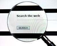 Magnifying glass on Search the Web service. Magnifying glass over web search form on website Royalty Free Stock Photos