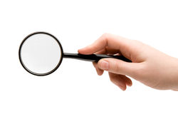 Magnifying glass (searching). Magnifying glass hold in female right hand (searching royalty free stock photo