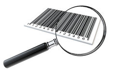 Magnifying glass searching bar codes Royalty Free Stock Photography