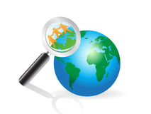 Magnifying glass searching on earth. The concept of magnifying glass searching on earth Royalty Free Stock Photos