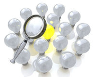 Magnifying glass searching for a good idea light bulb. In the design of information associated with the search for ideas Royalty Free Stock Photo