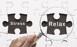 Magnifying glass searching missing puzzle peace Relax and Stress Stock Photo