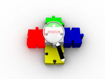 Magnifying glass searching on puzzle peace Stock Images