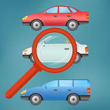 A magnifying glass selects a car. Stock Photos