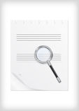 Magnifying glass with sheet of paper Royalty Free Stock Photos