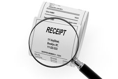 Magnifying glass & Shopping Receipt Royalty Free Stock Photo