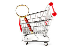 Magnifying glass & shopping trolley Stock Photos
