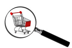 Magnifying glass & shopping trolley Royalty Free Stock Photo