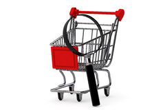 Magnifying glass & shopping trolley Royalty Free Stock Images
