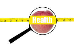 Magnifying glass showing apple health word and measure waist Royalty Free Stock Image