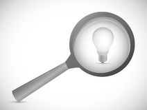Magnifying glass showing idea word Stock Photo