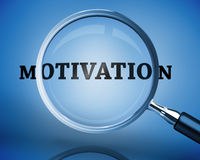 Magnifying glass showing motivation word Stock Image