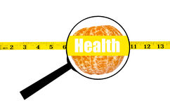 Magnifying glass showing orange health word and measure waist Royalty Free Stock Images