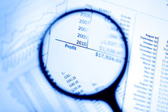Magnifying glass showing profit