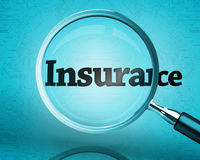 Magnifying glass showing the word insurance Royalty Free Stock Images