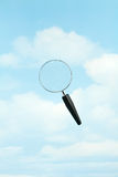 Magnifying Glass in the Sky Royalty Free Stock Image