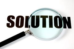 Magnifying glass - solution. Magnifying glass and text - solution Royalty Free Stock Image