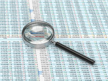 Magnifying glass on a spreadsheet. 3D rendering of  magnifying glass on a spreadsheet Royalty Free Stock Photo