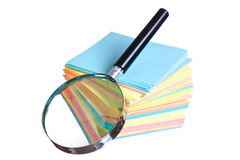 Magnifying glass and a stack of paper Stock Photo
