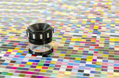 The magnifying glass standing on a leaf of the test print Royalty Free Stock Images