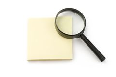 Magnifying glass and stickers Royalty Free Stock Photography