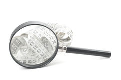 Magnifying glass and tape measure Royalty Free Stock Photos