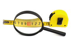 Magnifying glass and tapeline royalty free stock image