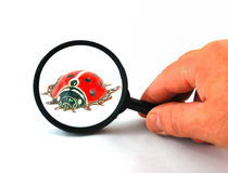 Magnifying glass and tin toy Stock Photography