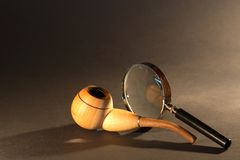 Magnifying Glass And Tobacco Pipe Stock Photo