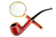 Magnifying Glass And Tobacco Pipe Royalty Free Stock Photos