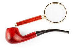 Magnifying Glass And Tobacco Pipe Stock Image