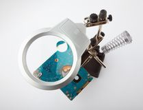Magnifying glass tool and hard drive Royalty Free Stock Photo