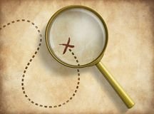 Magnifying glass and track with marked location on Stock Photos