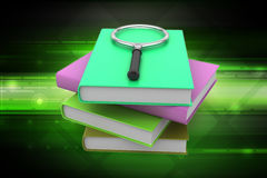 Magnifying glass trying to find the right book Stock Photography