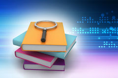 Magnifying glass trying to find the right book Stock Image