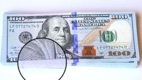 Magnifying glass view on a 100 dollar new bills Stock Photos