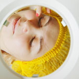 Magnifying glass view to threading procedure Stock Photo