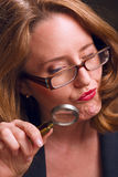 Magnifying glass woman Stock Photos