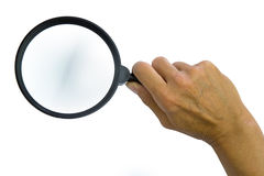 Magnifying glass in woman hand Stock Image