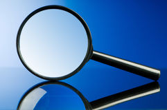 Magnifying glass with wooden handle Stock Photos