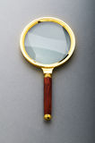 Magnifying glass with wooden handle Royalty Free Stock Photos