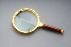 Magnifying glass with wooden handle Royalty Free Stock Photo